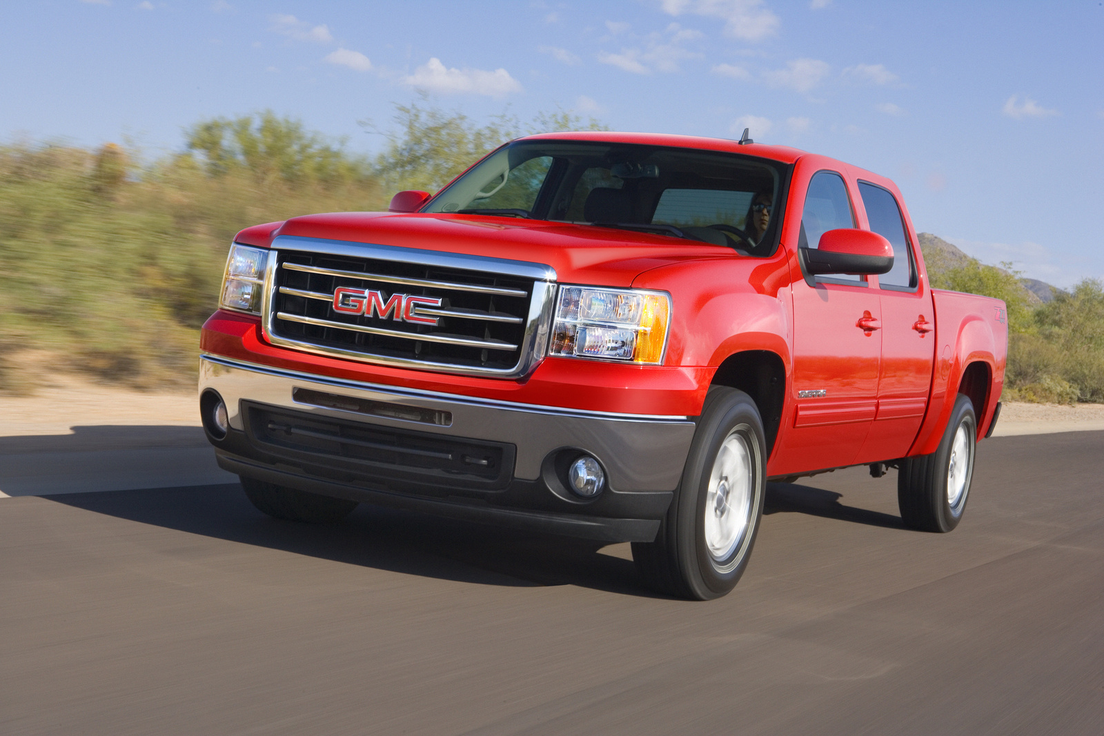 2013 GMC Sierra 1500, Front-quarter view. Copyright General Motors, exterior, manufacturer