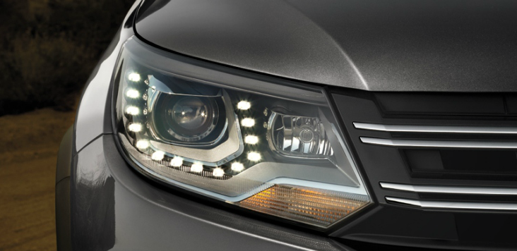 2013 Volkswagen Tiguan, Close-up of headlight., manufacturer, exterior