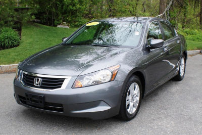 at what cost do i get a car sent to me in nigeria.HONDA SEDAN 2010