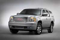 2013 GMC Yukon, Front-quarter view. Copyright General Motors, manufacturer, exterior