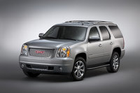 2013 GMC Yukon Denali, Front-quarter view. Copyright General Motors, exterior, manufacturer