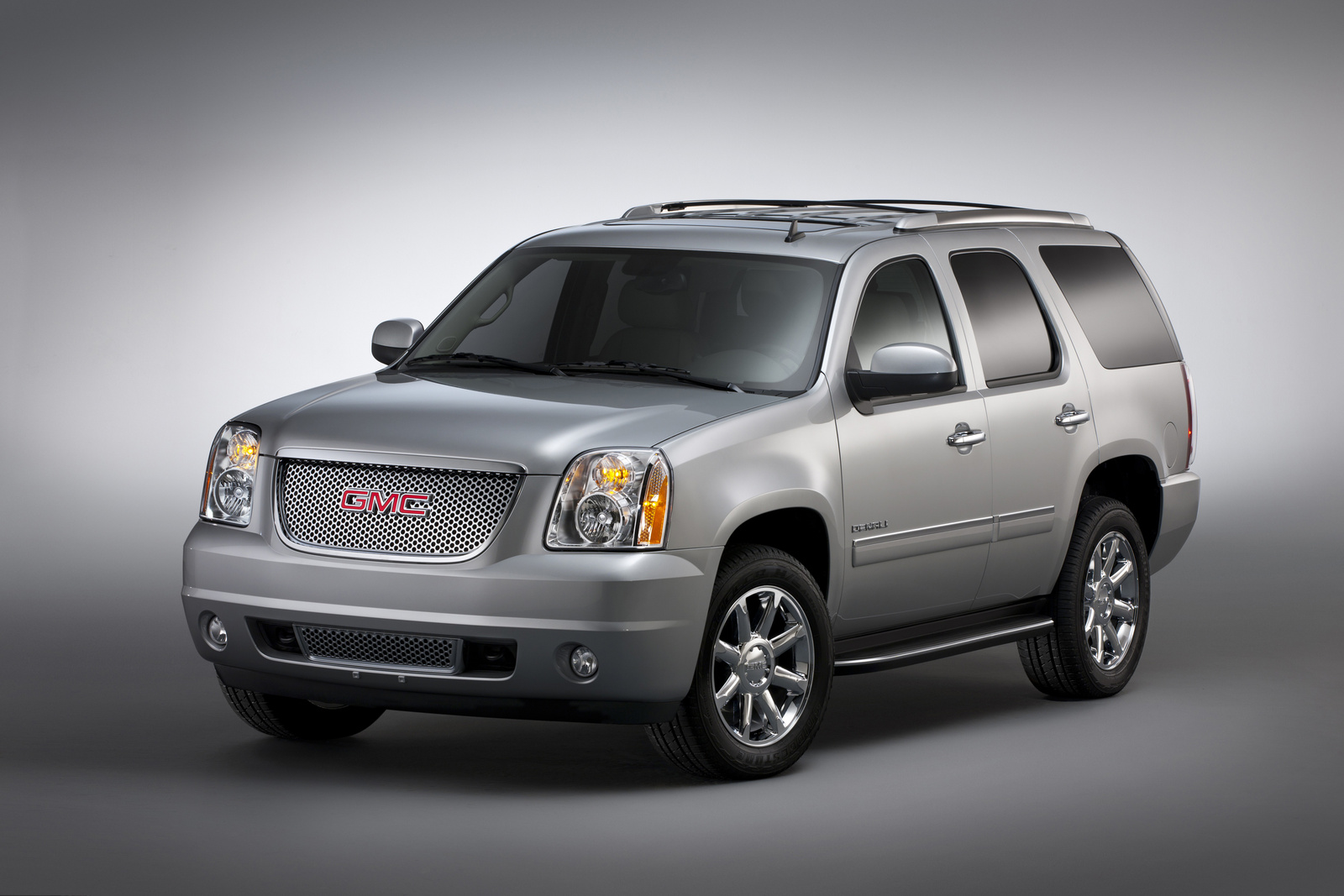 2013 GMC Yukon Denali, Front-quarter view. Copyright General Motors, manufacturer, exterior