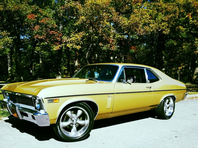 69 nova in rarely seen olympic gold! 307v-8 powerglide,deluxe strato buckets and console,fact 8-track stereo 4 spkr system,new additions include 17x7,18x8 coys c-5 wheels and cowl hood.