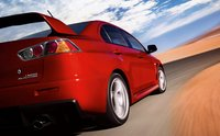 2013 Mitsubishi Lancer Evolution, Back quarter view., exterior, manufacturer