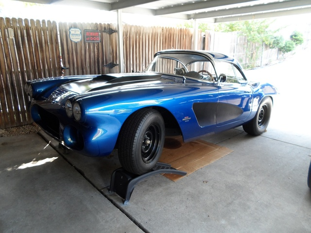 1961 Chevrolet Corvette Convertible Roadster, Changing oil & filter.  One of the more recent pic's, with a little black added. I changed the hood somewhat, and painted the cove (semi-gloss black) the ...