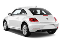 2013 Volkswagen Beetle TDI, The 2013 Beetle is an automotive icon reinvented. Placing the original Beetle and the 21st Century Beetle next to one another, it's clear that the lines of the rear section...