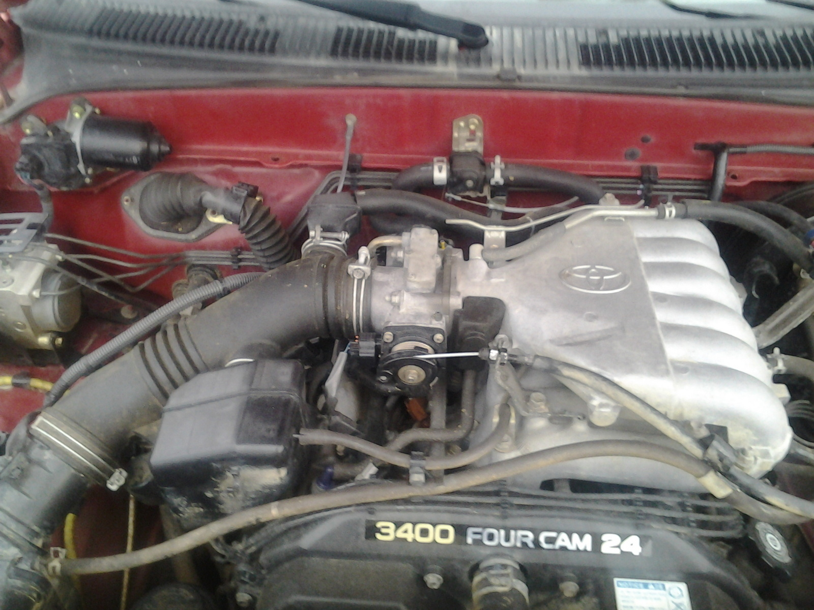 why is my 2003 tacoma idle high and slack in throttle line, after I  replaced the throttle body?
