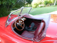 1954 Jaguar XK140, Burgundy interior with a camel top., interior