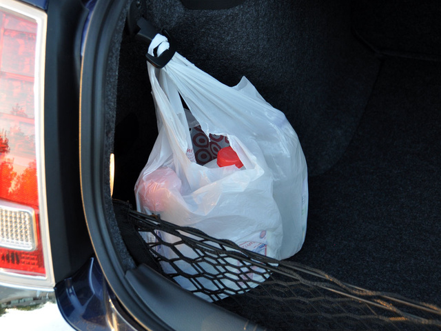 2013 Chrysler 300, Hooks and a net make stowing cargo easy, interior, gallery_worthy