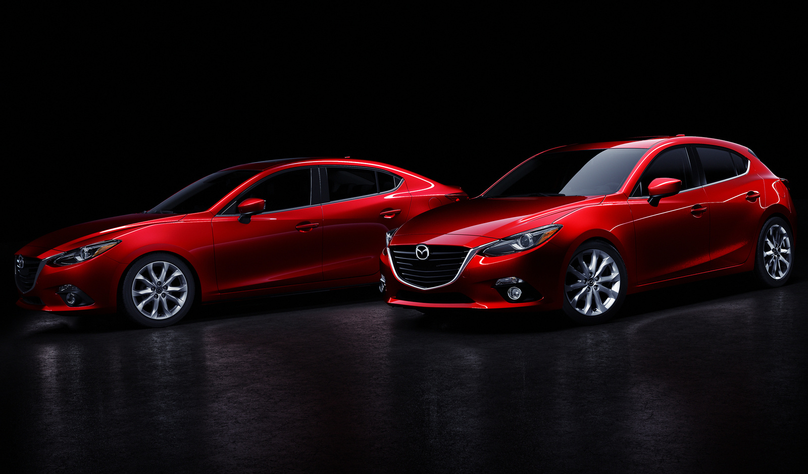 Front-quarter views of the sedan and hatchback