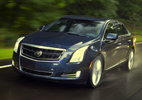 2014 Cadillac XTS, Front-quarter view. Copyright General Motors, manufacturer, exterior
