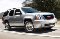 2014 GMC Yukon, Front-quarter view. Copyright General Motors, manufacturer, exterior