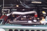 Picture of 1999 Jeep Wrangler SE, engine
