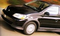 2000 Toyota ECHO 4 Dr STD Sedan, Photo: Car and Driver http://www.caranddriver.com/reviews/toyota-echo-road-test, exterior