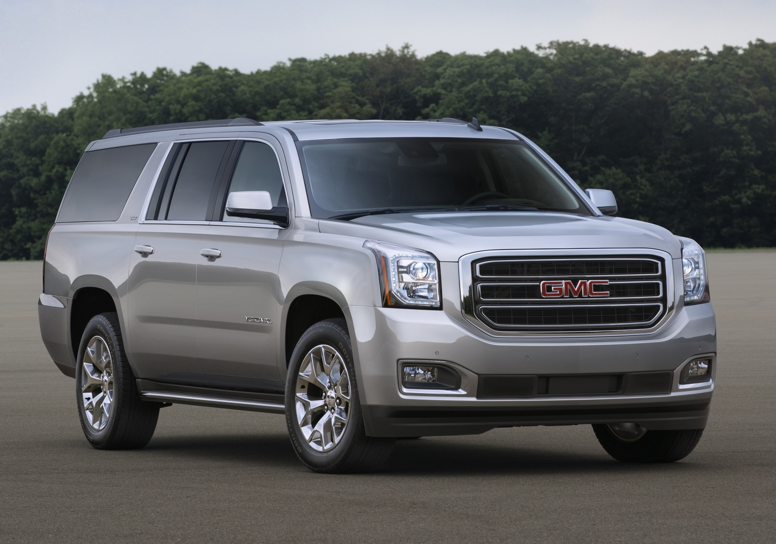 tahoe suburban driving gmc and drive consumer daily guide chevrolet the yukon