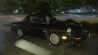 1989 Alfa Romeo Spider, raining at night, exterior