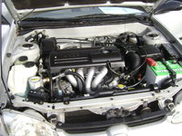 Picture of 2002 Chevrolet Prizm 4 Dr STD Sedan, engine