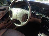 Picture of 1999 Oldsmobile Aurora 4 Dr STD Sedan