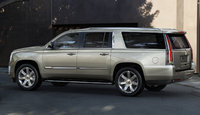 2016 Cadillac Escalade, Rear-quarter view. Copyright General Motors, exterior, manufacturer