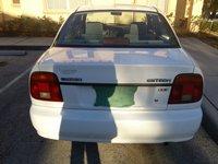 Picture of 2002 Suzuki Esteem 4 Dr GL Sedan, exterior
