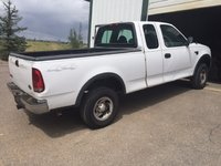 Picture of 2000 Ford F-150 XL 4WD Extended Cab LB, exterior