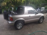 Picture of 2000 Kia Sportage Base 4WD Convertible, exterior
