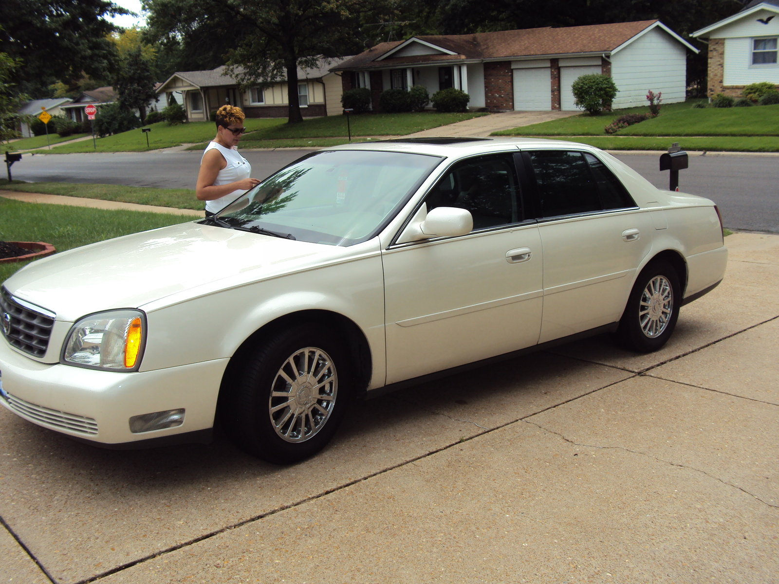 How much is a 2003 deville dhs worth