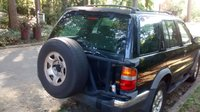 Picture of 1999 Nissan Pathfinder 4 Dr LE 4WD SUV, exterior