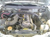 Picture of 1999 Chevrolet Tracker 4 Dr STD 4WD SUV, engine