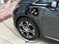 2017 Chevrolet Bolt EV Premier, 2017 Chevrolet Bolt EV plugged in to charge, exterior, gallery_worthy