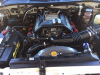 Picture of 1999 Isuzu VehiCROSS 2 Dr STD 4WD SUV, engine