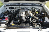 Picture of 2004 Nissan Frontier 4 Dr SC Supercharged 4WD Crew Cab SB, engine