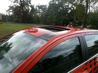 2012 Chevrolet Sonic LTZ Hatchback, Power sunroof with tilt and sunshade., exterior, gallery_worthy