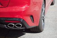Rear wheel and exhaust detail of the 2018 Kia Stinger., exterior, gallery_worthy