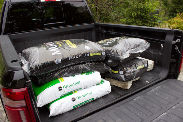 Rear bed area of the 2019 Ram 1500 (topsoil and bark mulch not included).