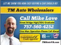 TM Auto Wholesalers logo
