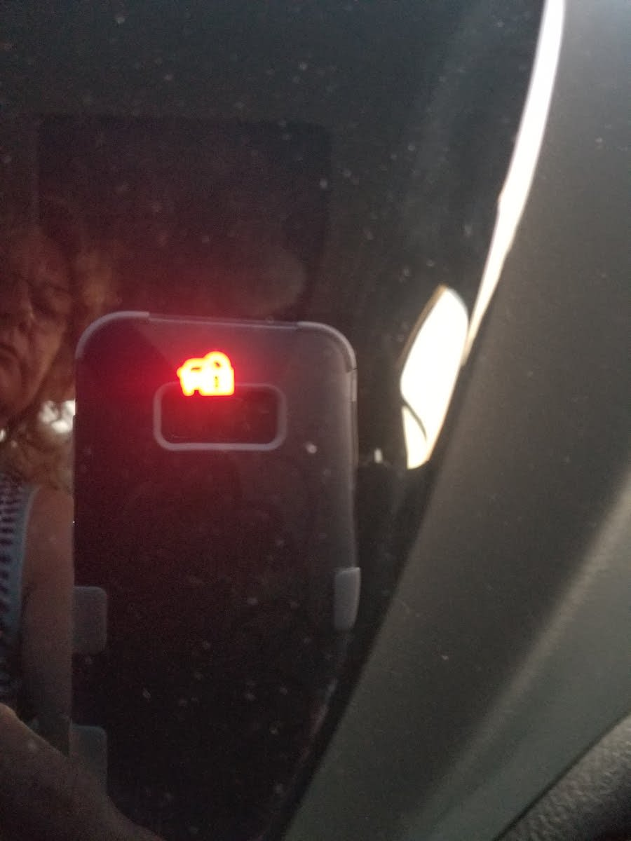 Toyota Corolla Questions - What is the red flashing light in