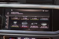 Audi MMI screen of the 2019 Audi Q3. Note the wireless charging reminder., interior, gallery_worthy