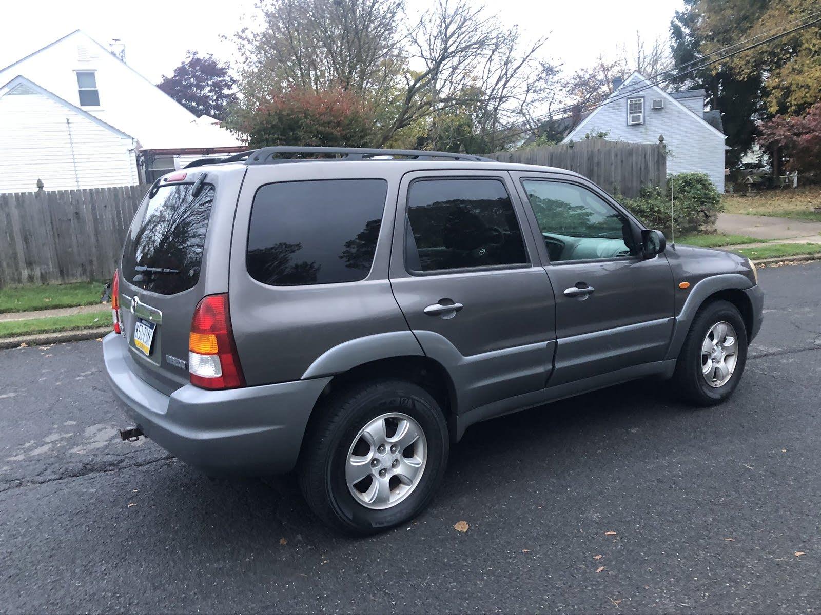 Kelebihan Mazda 2002 Perbandingan Harga