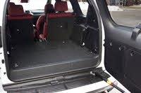 Rear cargo area of the 2020 Lexus GX. Note the side-opening rear hatch., gallery_worthy
