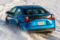 2020 Toyota Prius rear three quarter snow driving, exterior, manufacturer, gallery_worthy